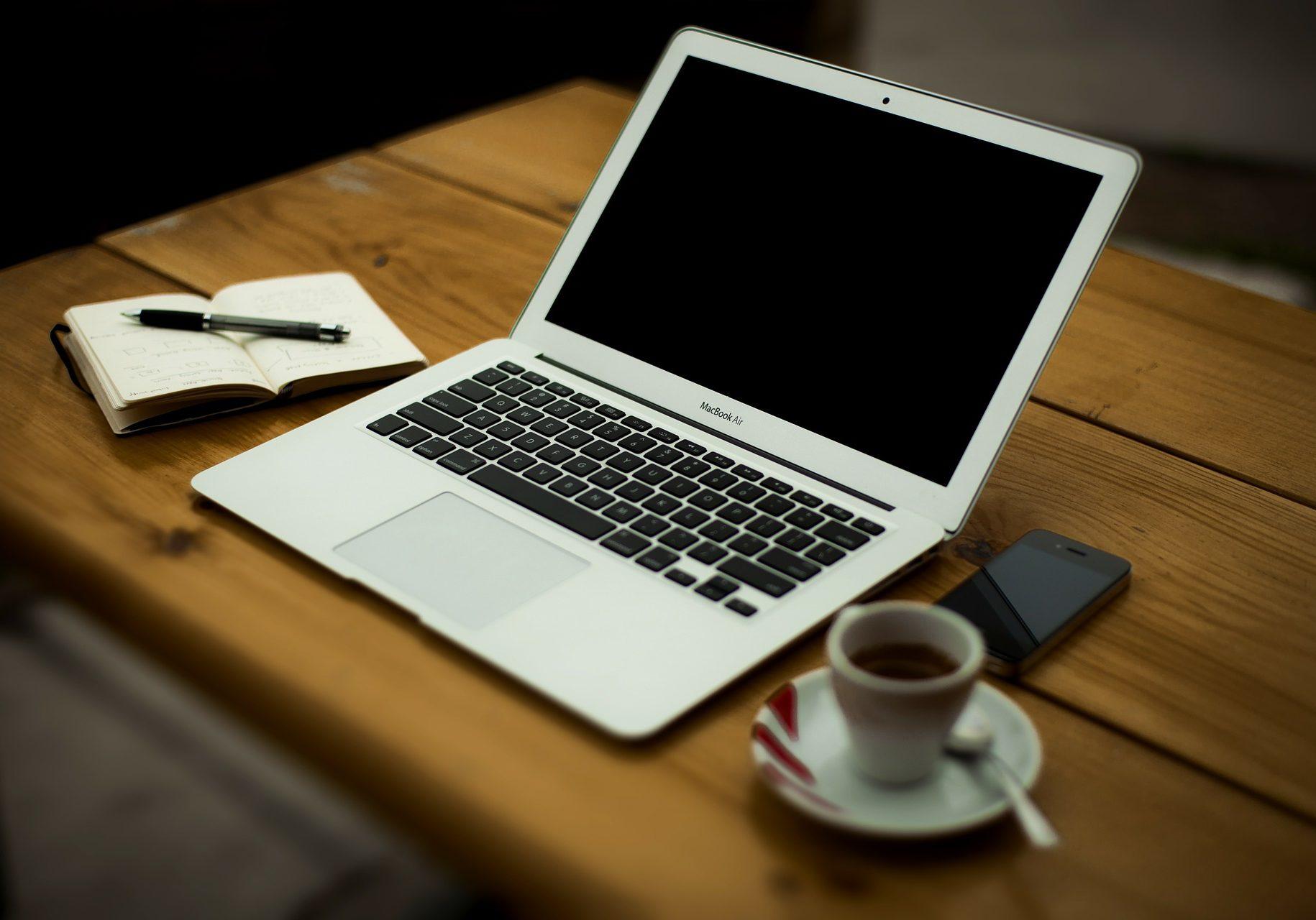 Openlaptopnotebookpenespressophonedesk